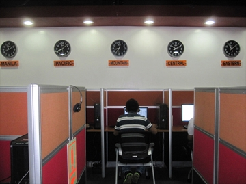 Visaya  Don Lee,Los Angeles Times  A worker at Visaya's call centre in central Manila sits undeer a wall of clocks showing the times in different parts of the United States. Waterloo Region Record